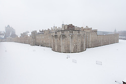 © Licensed to London News Pictures. 20/10/2013. London, UK. The moat around the Tower of London is covered by a blanket of snow on 20 January 2013. Heavy snow has hit London and is forecast to continue for the next four days. Photo credit : Vickie Flores/LNP