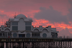 © Licensed to London News Pictures. 21/09/2016. Portsmouth, UK.  Dramatic orange skies on display during sunrise over South Parade Pier in Southsea this morning, 21st September 2016. Photo credit: Rob Arnold/LNP