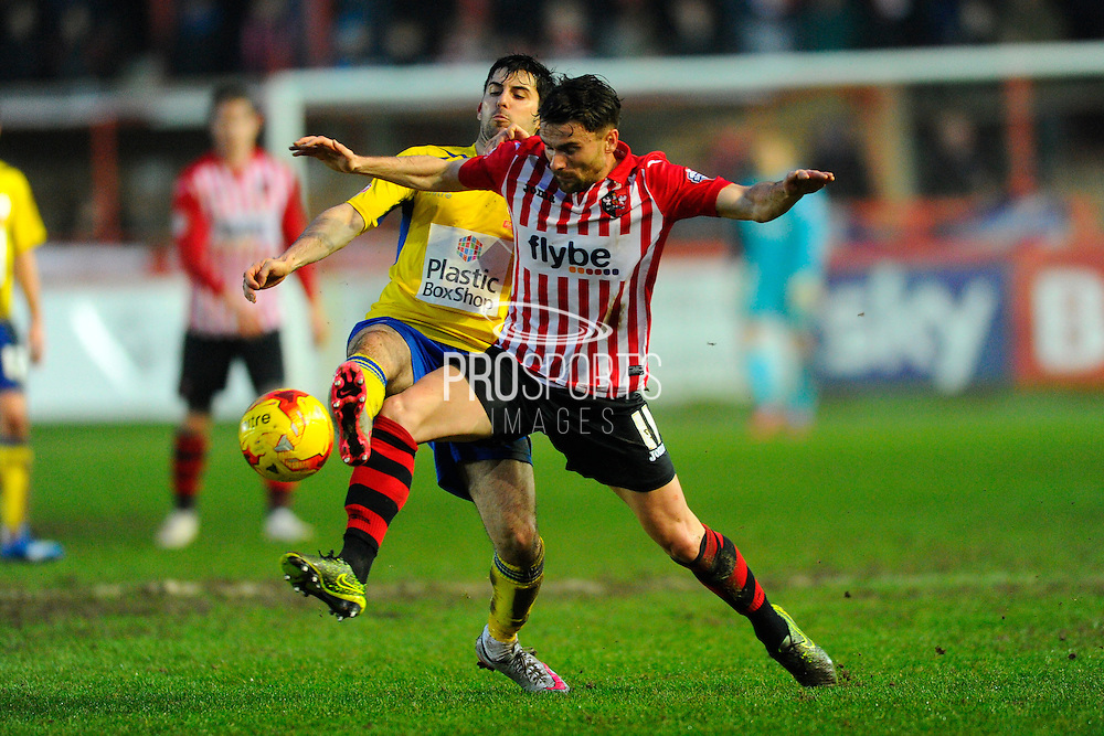 Accrington Stanley's Piero Mingoia and Exeter City's Arron Davies during the Sky Bet League 2 match between Exeter City and Accrington Stanley at St James' Park, Exeter, England on 23 January 2016. Photo by Graham Hunt.