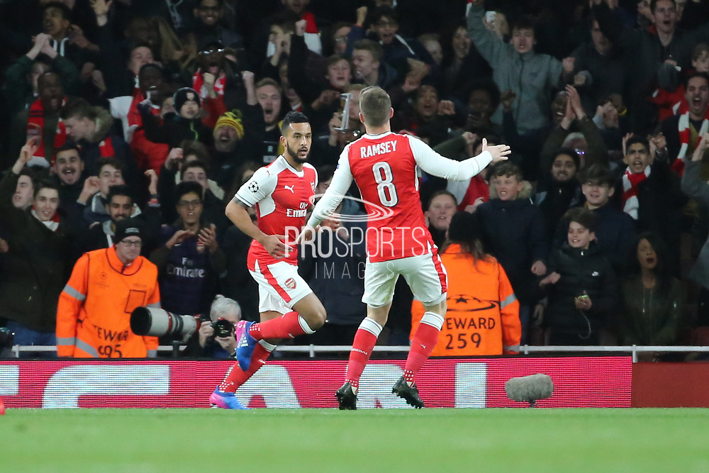 Arsenal attacker Theo Walcott (14) celebrating after scoring 1-0 during the Champions League round of 16, game 2 match between Arsenal and Bayern Munich at the Emirates Stadium, London, England on 7 March 2017. Photo by Matthew Redman.