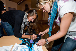 Ilka Semmler and Laura Ludwig of Germany signing autographs on official jerseys of this tournament at Technical meeting of CEV European Continental Beach Volleyball Cup for Olympic Qualification, on September 5, 2010, in Zrece, Slovenia. (Photo by Matic Klansek Velej / Sportida)