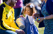 Sylvia Jaco, 2, celebrates her Easter egg collection with her parents during the 21st Annual Easter Egg Hunt at Winnequah Park in Monona, WI on Saturday, April 20, 2019.