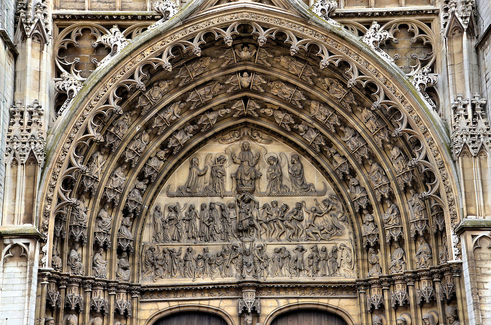 Cathedral of Our Lady Portal of Last Judgment in Antwerp, Belgium <br /> The tympanum above the Cathedral of Our Lady&rsquo;s main portal is an exquisite depiction of the Last Judgment.  Look closely at the relief: on the left side are those destined for heaven and on the right are those banished to hell. More statues of saints and angels delight the eye in the ornamental molding of the archivolt that surrounds the arch.