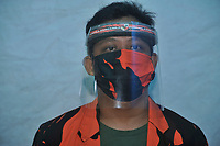 04-11-2020 | Medan, Indonesia: A journalist seen using the full face protective tools to focus reporting the Corona Virus Disease 19 (COVID-19) outbreak in Medan, North Sumatra province, Indonesia on April 11, 2020. The Head of Pancasila youth organization in North Sumatra province, Kodrat Shah said, if journalists must prioritize the readiness of health protective devices to coverage the related of Covid-19 outbreak.