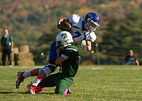 Newfound's Logan Rouille wraps up IL/MA's Mark Macdonald during NHIAA Division III football on Saturday afternoon.  (Karen Bobotas/for the Laconia Daily Sun)