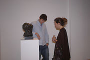 Richard O'Hagan and Amanda Shepherd. Bronze Sculpture by Georgiana Anstruther-Gough-Calthorpe. Air Gallery. Dover St. London. 27 September 2005. ONE TIME USE ONLY - DO NOT ARCHIVE © Copyright Photograph by Dafydd Jones 66 Stockwell Park Rd. London SW9 0DA Tel 020 7733 0108 www.dafjones.com
