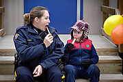 Kelowna RCMP Constable Colleen Lowing  enjoys some taffy with her son at aMaple Festival on March 13.