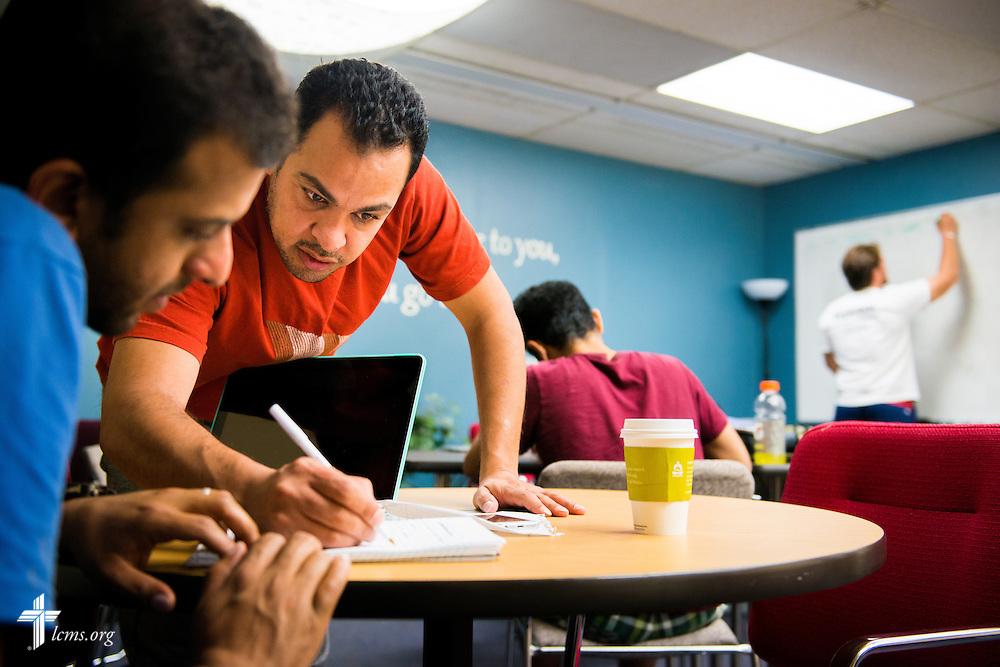 Fayez Alghobeni helps Meshal Abushanaq during a math tutoring class at Concordia University, Saint Paul, on Tuesday, August 5, 2014, in St. Paul, Minn.   LCMS Communications/Erik M. Lunsford