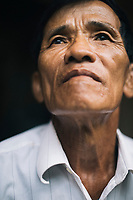 A portrait of Nguyen Hong Man at his home in central Vietnam. Man is a survivor of the My Lai Massacre in Quang Ngai Province, where over 500 innocent villagers were murdered by US troops in 1968.