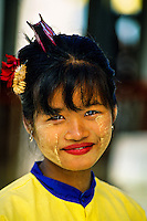 Burmese woman wearing thanaka bark makeup, Shwedagon Pagoda, Yangon (Rangoon), Burma (Myanmar)