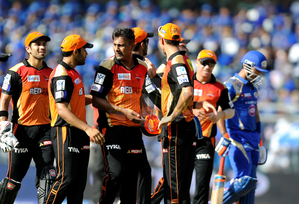 Praveen Kumar of Sunrisers Hyderabad celebrates the wicket of Unmukt Chand of Mumbai Indians during match 23 of the Pepsi IPL 2015 (Indian Premier League) between The Mumbai Indians and The Sunrisers Hyferabad held at the Wankhede Stadium in Mumbai India on the 25th April 2015.<br /> <br /> Photo by:  Pal Pillai / SPORTZPICS / IPL