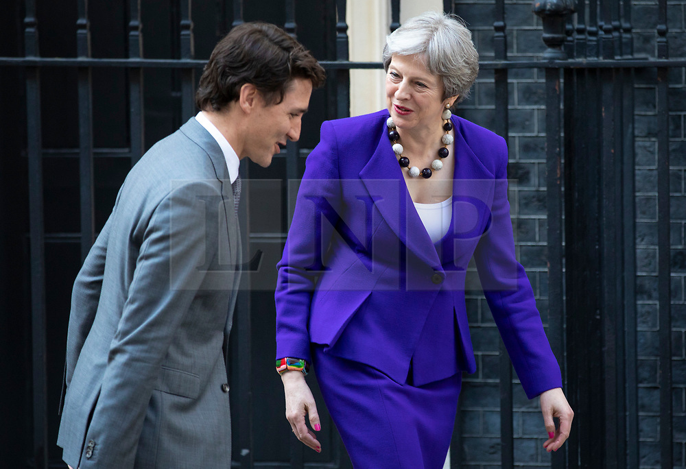 © Licensed to London News Pictures. 18/04/2018. London, UK. Prime Minister of Canada Justin Trudeau (L) and Prime Minister Theresa May (R) greet each other on Downing Street. Photo credit: Rob Pinney/LNP