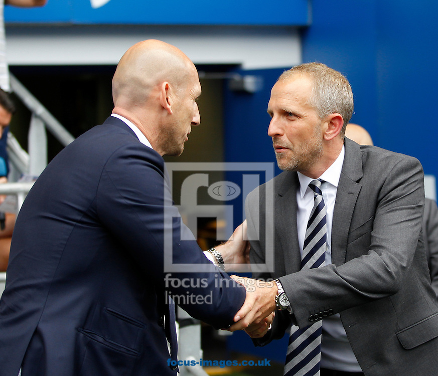 Paul Trollope of Cardiff City and Jaap Stam of Reading during the Sky Bet Championship match at the Cardiff City Stadium, Cardiff<br /> Picture by Mike Griffiths/Focus Images Ltd +44 7766 223933<br /> 27/08/2016
