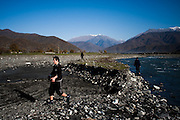 Boys pick up rocks to be used on a building site from the Alazani River. Duisi, Republic of Georgia.