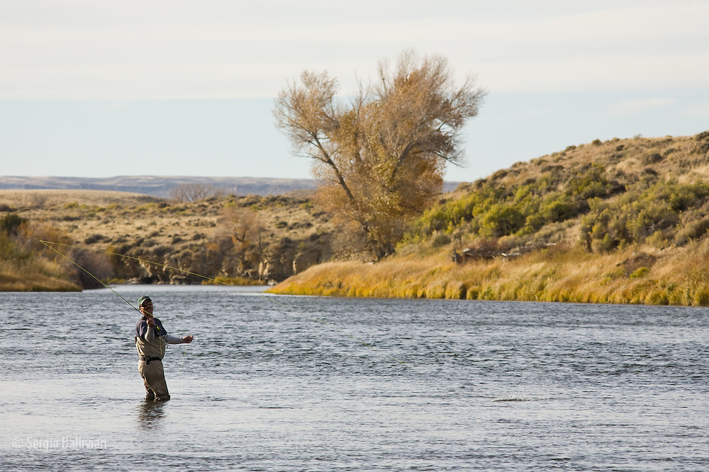 A flyfisherman casts as the sun begins to set on the North Platte River in Wyoming in mid-October.