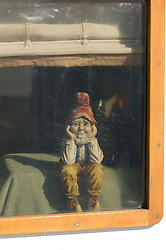 Garden Gnome sitting in a window