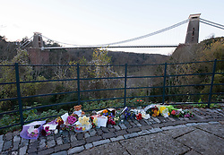 © Licensed to London News Pictures. 05/12/2014. Bristol, UK.  Flowers and tributes left at Sion Hill viewing point by the Clifton Suspension Bridge, after the bodies of Charlotte Bevan age 30 and her 4 day old baby daughter Zaani Tiana Bevan Malbrouck were found in the Avon Gorge near the bridge after they went missing on Tuesday night from St Michael's Hospital in Bristol. Photo credit: Simon Chapman/LNP