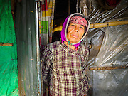 04 MARCH 2017 - KATHMANDU, NEPAL: A resident of an IDP camp in the center of Kathmandu. The camp opened days after the April 2015 earthquake devastated Nepal, killing almost 9,000 people. At its peak, about 1,800 families lived in the camp. The camp is still open nearly two years after the earthquake, about 400 families currently live in the camp. Camp residents say the Kathmandu municipal government is trying to close the camp and is encouraging residents to find new housing. They said the government is cutting off services to the camp and last week stopped the free distribution of water, although water can be purchased for delivery. Most of the people in the camp came to Kathmandu from rural villages in the mountains in the weeks after the earthquake. Many of the residents of the camp, technically homeless, have found work in Kathmandu's bustling construction industry, rebuilding homes destroyed in the earthquake.       PHOTO BY JACK KURTZ