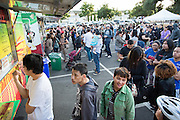 Foodies wait in lines at various food trucks during Off the Grid at the Great Mall of the Bay Area in Milpitas, California, on May 12, 2016. (Stan Olszewski/SOSKIphoto)