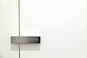 minimalistic door lock on public toilet door in Japan
