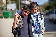 Portrait of two boys which are friends on the way home from school - in the city of Crnik.