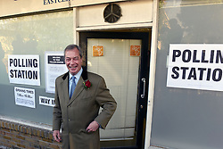 © London News Pictures. 07/05/2015. Leader of the UK Independence Party (UKIP) Nigel Farage leaves the Echo Shop polling station on Plains of Waterloo road, Ramsgate, Kent, UK after registering his vote in the constituency where he hopes to be elected in the 2015 election. Photo credit: Mary Turner/LNP