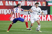 Atletico de Madrid´s Diego Godin (L) and Real Madrid´s Gareth Bale during 2014 Supercopa de España `Spain Supercup´ second leg match at Vicente Calderon stadium. August 22, 2014. (ALTERPHOTOS/Victor Blanco)