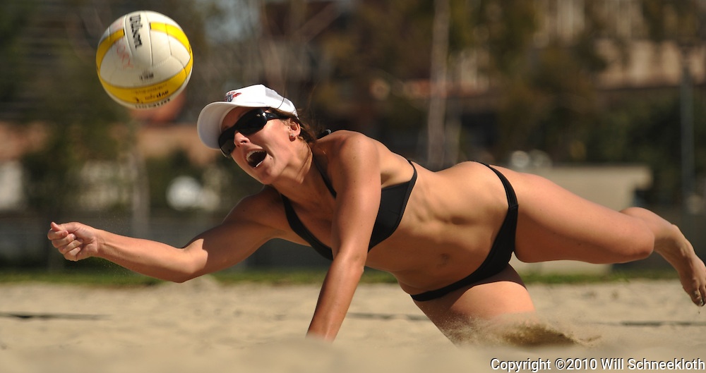 AVP beach volleyball player Sidney Donahue dives for a dig during a scrimmage at Californa State University Long Beach in Long Beach, CA on April 8, 2010.