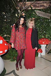 Left to right, JO WOOD and JANICE DICKINSON at Mulberry's party following their fashion show as part of London Fashion Week Autumn Winter Collection 2011 held at Claridges, Brook Street, London on 20th February 2011.