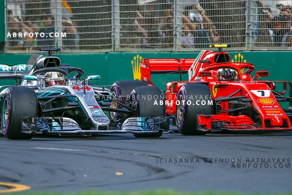 Mercedes driver Lewis Hamilton of Britain overtakes Ferrari driver Kimi Raikkonen of Finland at turn Ferrari driver Kimi Raikkonen of Finland during the 2018 Rolex Formula 1 Australian Grand Prix at Albert Park, Melbourne, Australia, March 24, 2018.  Asanka Brendon Ratnayake