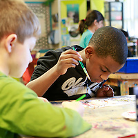 Thomas Wells   BUY AT PHOTOS.DJOURNAL.COM<br /> Devontray Brewer, 6, tries to figure out what he wants to paint next on his snowman ornament during his first grade art project at Thomas Street Elementary School on Tuesday.