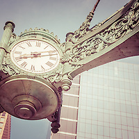Chicago clock vintage picture. The famous Chicago clock is on the Macy's building and is one of the Marshall Fields Great Clocks. Photo has a vintage retro tone. Image Copyright © Paul Velgos All Rights Reserved.