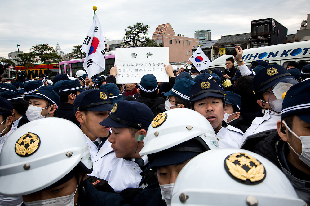 MATSUE, JAPAN - FEBRUARY 22 : Japanese and South Korean nationalists clash violently amid rallies over Dokdo/Takeshima territorial dispute prior to the Takeshima Sovereignty Ceremony, Takeshima Day, a small disputed island controlled by South Korea which it calls Dokdo and Japan calls it Takeshima, in Matsue in Shimane Prefecture, western Japan on Feb. 22, 2017. Japan urged South Korea to return disputed islets, The sovereignty issue over the islands has been the subject of a long territorial dispute between South Korean and Japan. (Photo by Richard Atrero de Guzman/NUR Photo)