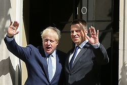 © Licensed to London News Pictures. 06/08/2019. London, UK. British Prime Minister BORIS JOHNSON (L) and Prime Minister of Estonia and Leader of the Centre Party JÜRI RATAS (R) on the steps of no 10 Downing Street.  Photo credit: Dinendra Haria/LNP
