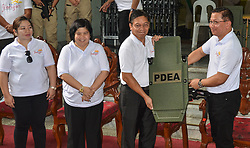 April 24, 2018 - Quezon City, Metro Manila, Philippines - The firearms, protective and IT equipment presented has a total amount of Php 202,861,835.00 which will be distributed to all PDEA operating units in the country. (Credit Image: © Robert Oswald Alfiler/Pacific Press via ZUMA Wire)