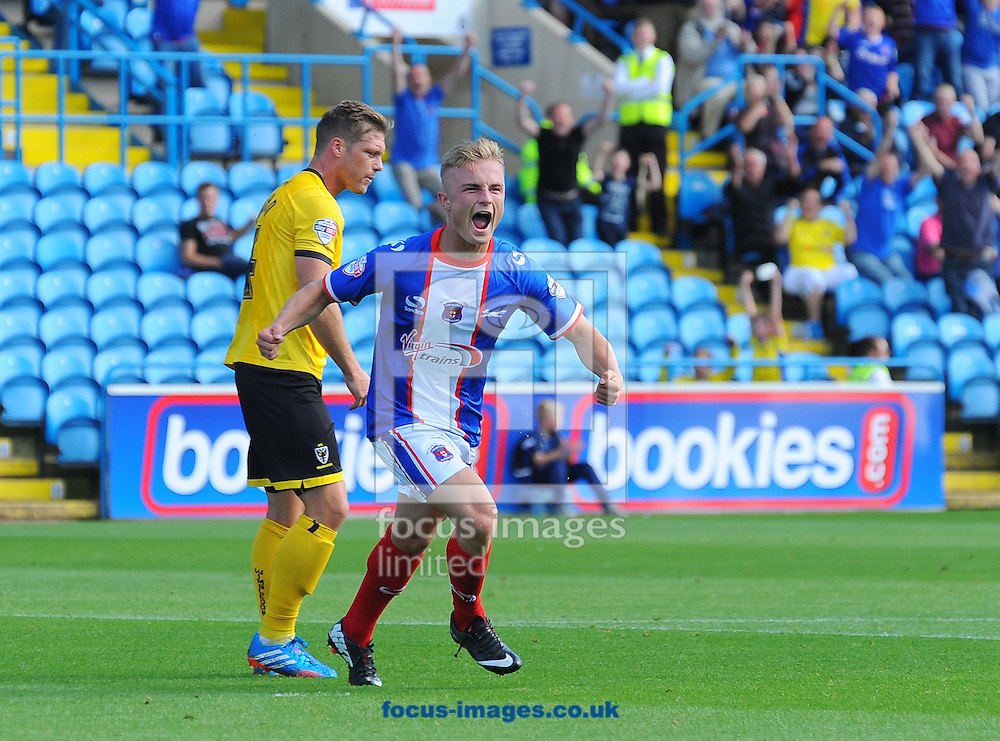Kyle Dempsey of Carlisle United (right) celebrates scoring from a header his team's first goal during the Sky Bet League 2 match at Brunton Park, Carlisle<br /> Picture by Greg Kwasnik/Focus Images Ltd +44 7902 021456<br /> 06/09/2014