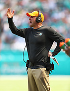 Sep 23, 2018; Miami Gardens, FL, USA; Miami Dolphins associate head coach Darren Rizzi yells at his team at Hard Rock Stadium against the Oakland Raiders. The Dolphins defeated the Raiders 28-20. (Steve Jacobson/Image of Sport)