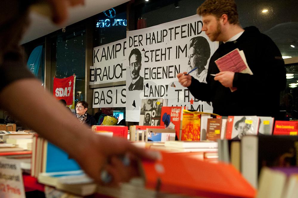 """08 JAN 2011, BERLIN/GERMANY:<br /> Verkauf von Buechern und ein Transparent mit der Aufschrift """"Der Hauptfeind steht im eigenen Land!"""",16. Internationale Rosa-Luxenburg-Konferenz, Urania Haus<br /> IMAGE: 20110108-01-005<br /> KEYWORDS: Kommunismus"""