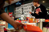 08 JAN 2011, BERLIN/GERMANY:<br /> Verkauf von Buechern und ein Transparent mit der Aufschrift &quot;Der Hauptfeind steht im eigenen Land!&quot;,16. Internationale Rosa-Luxenburg-Konferenz, Urania Haus<br /> IMAGE: 20110108-01-005<br /> KEYWORDS: Kommunismus
