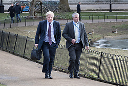 © Licensed to London News Pictures. 05/03/2018. London, UK. Foreign Secretary Boris Johnson (L) walks in St James's Park with his bodyguard. Later Prime Minister Theresa May make a statement in Parliament about the UK/EU future economic partnership. Photo credit: Peter Macdiarmid/LNP
