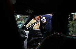 Police Chief Cathy L. Lanier gets in a car on patrol in Washington, D.C. on March 16, 2009. Lanier, chief of police with the Metropolitan Police Department of the District of Columbia, MPDC, rose to her position from humble beginnings: she was a high-school dropout after ninth grade and an unwed mother at the age of 15. Despite a rough start, she later earned advanced academic degrees from the Johns Hopkins University and the Naval Postgraduate School in Monterey, Calif., where she completed a Masters in Security Studies. Lanier also attended the John F. Kennedy School of Government at Harvard University and is a graduate of the FBI Academy and the University of the District of Columbia. She has been on the force for 18 years.