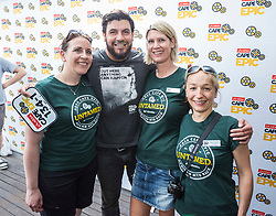 Riaan Manser with the Volunteer ladies from Switzwerland during the pre race events held at the V&A Waterfront in Cape Town prior to the start of the 2017 Absa Cape Epic Mountain Bike stage race held in the Western Cape, South Africa between the 19th March and the 26th March 2017<br /> <br /> Photo by Dominic Barnardt/Cape Epic/SPORTZPICS<br /> <br /> PLEASE ENSURE THE APPROPRIATE CREDIT IS GIVEN TO THE PHOTOGRAPHER AND SPORTZPICS ALONG WITH THE ABSA CAPE EPIC<br /> <br /> ace2016