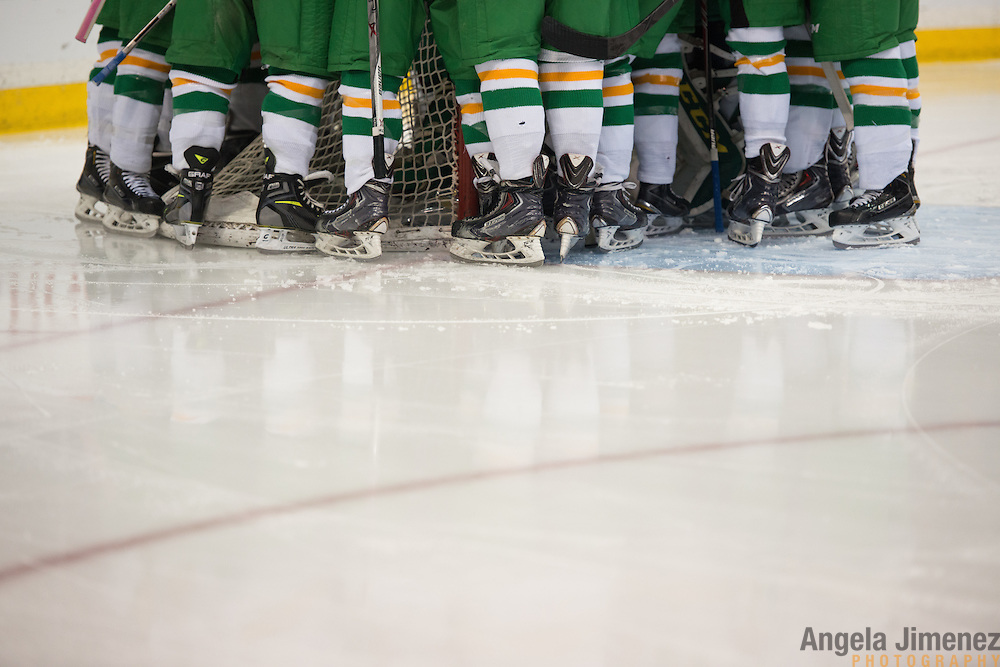 Edina players huddle before the Class AA semifinal game between Duluth East and Edina (Duluth East won 3-1) at the Minnesota State High School League Boys' State Hockey Tournament at the Xcel Energy Center in St. Paul, Minnesota on March 6, 2015. <br />  <br /> <br /> Photo by Angela Jimenez for Minnesota Public Radio www.angelajimenezphotography.com