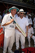 Eric Clapton vs Alec Stewart  Bunbury X1 cricket match. Ripley court school. Ripley.  Proceeds to the Testimonial and cross Roads clinic, Antigua and NSPCC.  10 August 2003. © Copyright Photograph by Dafydd Jones 66 Stockwell Park Rd. London SW9 0DA Tel 020 7733 0108 www.dafjones.com