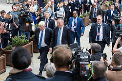 © Licensed to London News Pictures  . 03/10/2017 . Manchester , UK . BORIS JOHNSON crosses from the Midland Hotel to the Conference Centre , surrounded by media , ahead of delivering his keynote speech ,n day three of the Conservative Party Conference at the Manchester Central Convention Centre . Photo credit : Joel Goodman/LNP