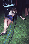 Cardiff University Ball in Cooper's Field, Cardiff, Wales, May 2000. Photograph © Rob Watkins. Pictured: A girl being sick near the main stage