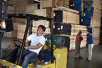 Forklift Driver in Lumber Warehouse by Supervisors