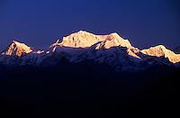 Sunrise on the Kanchenjunga Range (28,208 foot Mt. Kanchenjunga in center), West Sikkim, India