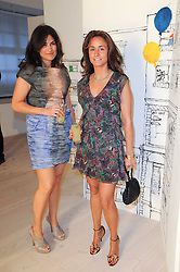 Left to right, DIALA KHLAT and SEDA ARBIB at a dinner hosted by Harper's Bazaar to celebrate Browns 40th Anniversary in aid of Women International held at The Regent Penthouses & Lofts, 16-18 Marshall Street, London on 20th May 2010.