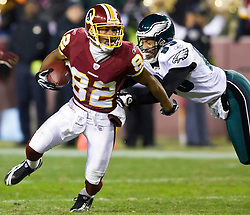 Washington Redskins wide receiver Antwaan Randle El (82) sheds a tackle attempt by Philadelphia Eagles wide receiver Greg Lewis (83) on a punt return.  The Washington Redskins defeated the Philadelphia Eagles 10-3 in an NFL football game held at Fedex Field in Landover, Maryland on Sunday, December 21, 2008.